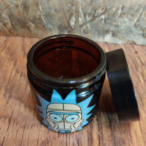 צנצנת זכוכית קטנה בצבע שחור ריק ומורטי